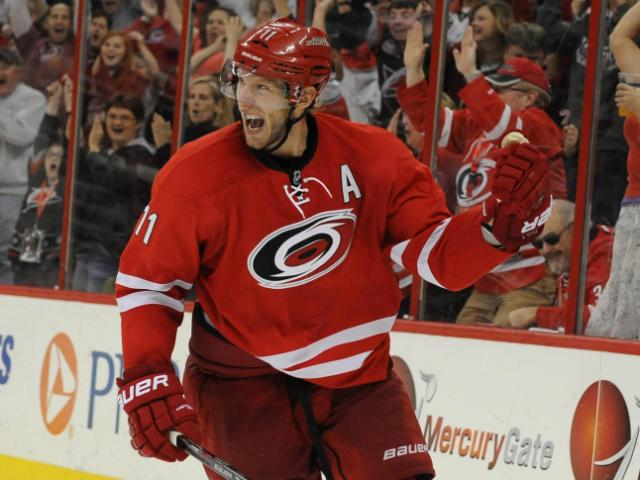 Jordan Staal (11) reacts to scoring a goal during the third period of action at PNC Arena between the Carolina Hurricanes and the San Jose Sharks on December 6, 2013 in Raleigh, NC.  (Photo by: Will Bratton)