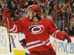 Elias Lindholm (16) reacts to scoring a goal during action at PNC Arena between the Carolina Hurricanes and the San Jose Sharks on December 6, 2013 in Raleigh, NC.  (Photo by: Will Bratton)