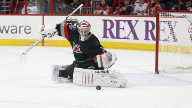 Anton Khudobin (31) gets his pads down to make a save. The Hurricanes defeated the Maple Leafs 6-1 on January 9, 2014 at the PNC Arena in Raleigh, North Carolina. Photo by: Jerome Carpenter