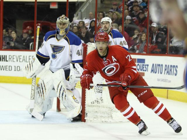 Carolina Hurricanes center Manny Malhotra (22) crosses behind the net looks for a centering pass. Carolina Hurricanes host the St. Louis Blues at the PNC Arena on Friday January 31, 2014. The Hurricanes played a solid game  and prevailed with a 3 to 1 victory. (Chris Baird / WRAL Contributor).