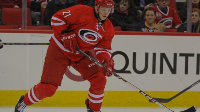 Carolina Hurricanes left wing Drayson Bowman (21) with the puck as the Carolina Hurricanes defeat the Buffalo Sabres 4-2 Thursday night March 13, 2014 at PNC Arena. (Photo by Jack Tarr/WRAL contributor.)