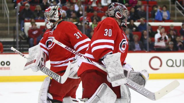 The Hurricanes substitute Anton Khudobin (31) for Cam Ward (30) in the first period. The Islanders defeated the Hurricanes 5-4 on March 25, 2014 at the PNC Arena in Raleigh, North Carolina. Photo by: Jerome Carpenter