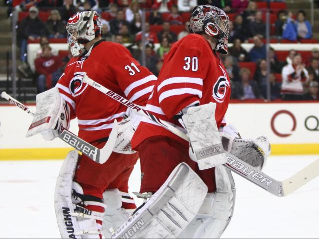 The Hurricanes substitute Anton Khudobin (31) for Cam Ward (30) in the first period. The Islanders defeated the Hurricanes 5-4 on March 25, 2014 at the PNC Arena in Raleigh, North Carolina. Photo by: Jerome Carpenter<br/>Photographer: Jerome  Carpenter