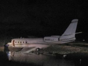 A Gulfstream 150 jet crash landed at the Key West airport Monday night. Four people on board, including NASCAR team owner Rick Hendrick and his wife Linda, were taken to Lower Keys Hospital. Two people had minor injuries and two were transported for precautionary reasons. (AP Photo/Monroe County Sheriff's Office, Evan Calhoun)