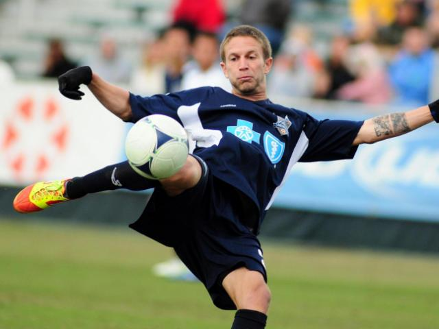 Brian Shriver (21) takes a shot during the Carolina RailHawks vs. Vancouver Whitecaps FC preseason soccer match in Cary, N.C. Sunday, March 4, 2012.<br/>Photographer: Will Bratton