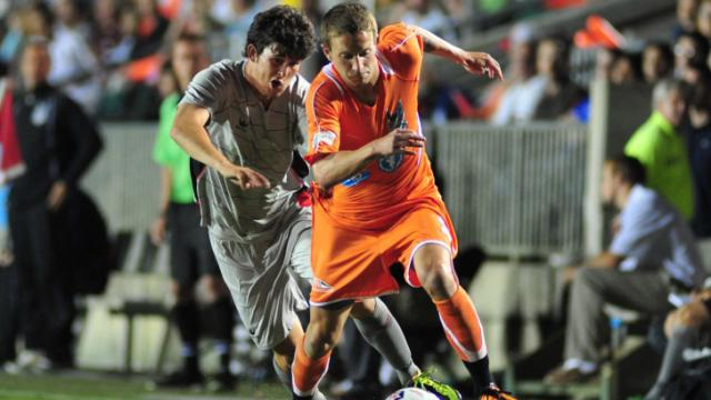 Brian Shriver (21) goes past a defender during the Carolina RailHawks vs. Atlanta Silverbacks NASL soccer game in Cary, N.C. Saturday April 14, 2012.