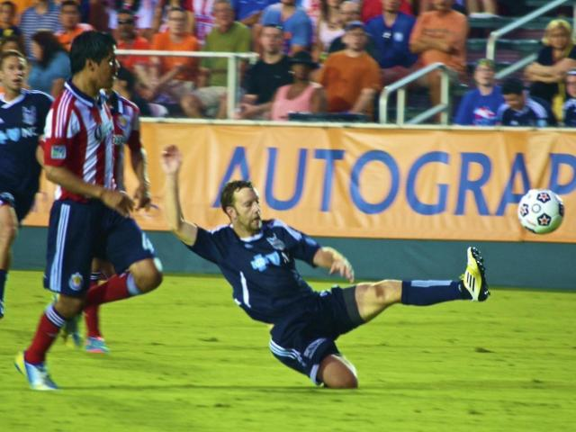 Carolina RailHawks Zack Schilawski slides for a pass during the RailHawks game against Chivas USA Wednesday, June 12, 2013 at WakeMed Soccer Park in Cary. (Photo by Andrew Drain)