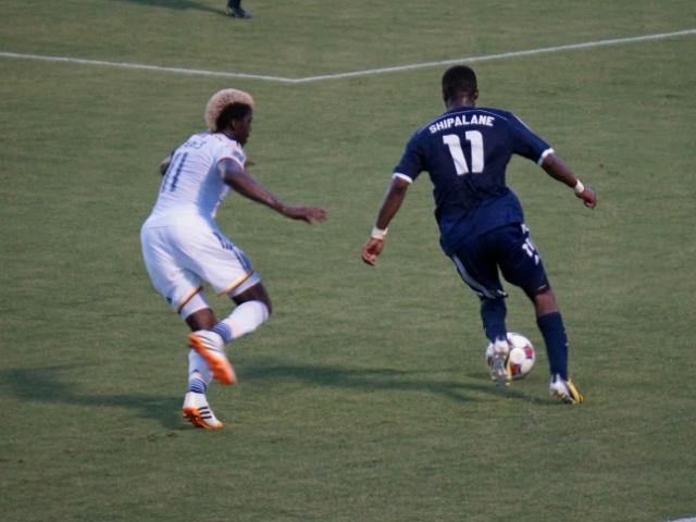 RailHawks Ty Shipalane dribbles up field during their match against the LA Galaxy Tuesday, June 24, 2014 at WakeMed Soccer Park. <br/>Photographer: Erin Summers