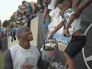 Cam Newton signs autographs at Panthers camp July 26, 2013.