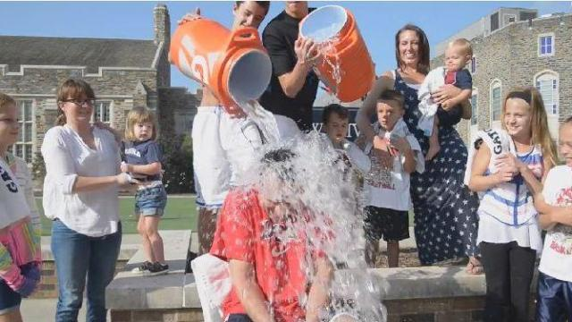 Duke head basketball coach Mike Krzyzewski accepted the ALS Ice Bucket Challenge Wednesday with a little help from his nine grandchildren.