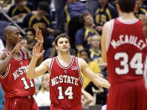 North Carolina State's Gavin Grant (11) and Engin Atsur, of Turkey, walk toward teammate Ben McCauley (34) as they begin to celebrate their 63-56 win over Drexel in an NIT first-round basketball game Tuesday, March 13, 2007, in Philadelphia. (AP Photo/Tom Mihalek)