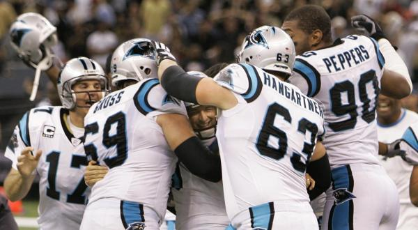 Carolina Panthers kicker John Kasay, center, is surrounded by his teammates after his field goal as time expired in an NFL football game in the Superdome in New Orleans on Sunday, Oct. 7, 2007. The Panthers won 16-13. (AP Photo/Alex Brandon)