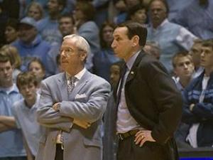 Coaches Roy Williams and Mike Krzyzewski stand on court during their 2007 matchup.