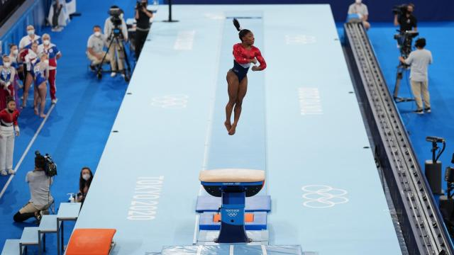 Simone Biles of the United States competes in vault during the women's team gymnastic's final at the delayed Tokyo 2020 Olympic Games in Tokyo on July 27, 2021. (Doug Mills/The New York Times)