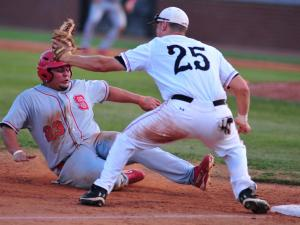 David Olson (25) makes the out on Danny Canela (23) during the Campbell University vs. North Carolina State University NCAA baseball game in Buies Creek, N.C. Tuesday April 17, 2012.