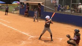 Young baseball player hits home run