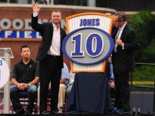 Chipper Jones waves to the crowd while making comments as part of a retirement ceremony for his Durham Bulls jersey #10 which he wore in 1992 while with the team. The ceremony, held at the Durham Bulls Athletic Park in Durham, NC, was for the fourth number to be retired by the organization.