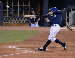 Jesus Flores hits the ball for the Durham Bulls against the Pawtucket Red Sox.