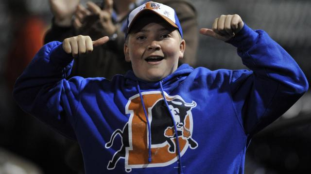 A young Bulls fan cheers during MiLB action between the Durham Bulls and the Norfolk Tides at the Durham Bulls Athletic Park on April 15, 2015 in Durham, NC. (Will Bratton/WRAL contributor)