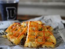 Tater tots, bacon, cheese and jalapenos are pressed into a waffle iron and served with sour cream.