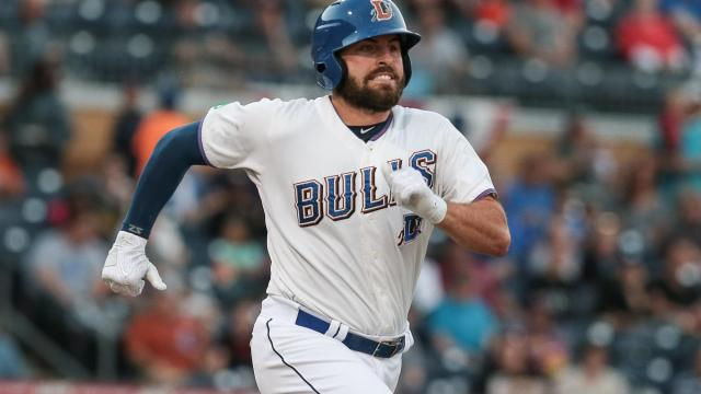 Patrick Leonard (30) of the Durham Bulls charges toward first.  (Chris Baird / WRAL Contributor).
