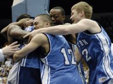 Overjoyed members of the Barton team hug each other following their 77-75 win over Winona State in the NCAA Division II basketball championship game in Springfield, Mass. Saturday, March 24, 2007. Players include Brandon Raffel (12), Bobby McNeil, in back and Spenser (cq) Briggs, right. (AP Photo/Nancy Palmieri)