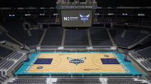 IMAGES: Hornets unveil beehive-themed playing court