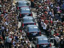 "Thousands of mourners and boxing fans lines the streets in Louisville, Kentucky, Friday, June 10, 2016, to say a final farewell to boxing great Muhammad Ali. The ""Greatest's"" casket was surrounded as it weaved through the streets."