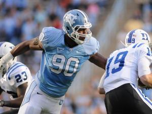 Quinton Coples (90) sacks Sean Renfree (19) during the North Carolina Tar Heels vs. Duke Blue Devils football game in Chapel Hill, N.C., Saturday, November 26, 2011.
