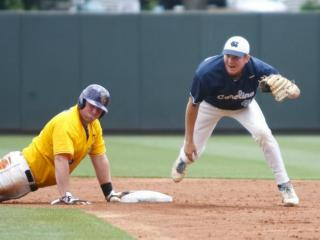 Michael Russell tags the bag to get Chase McDonald out at second during the UNC vs. ECU regional game on June 3, 2012 in Chapel Hill, NC.