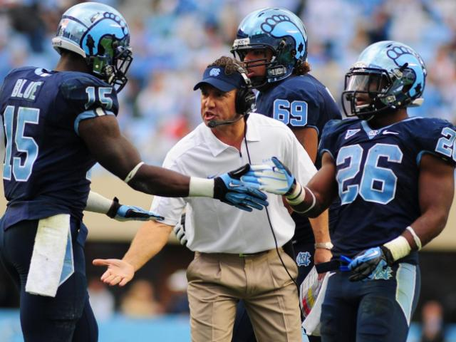 UNC head coach Larry Fedora reacts to a touchdown by A.J. Blue during the North Carolina Tar Heels vs. N.C. State Wolfpack NCAA football game, Saturday, October 27, 2012 in Chapel Hill, N.C.  <br/>Photographer: Will Bratton