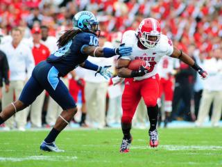 Tony Creecy (26) runs with the ball during the North Carolina Tar Heels vs. N.C. State Wolfpack NCAA football game, Saturday, October 27, 2012 in Chapel Hill, N.C.