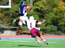 Tyron Laughinghouse (1) goes up for a catch during the Saint Augustine's University vs. Shaw University football game, Saturday, November 3, 2012 in Raleigh.