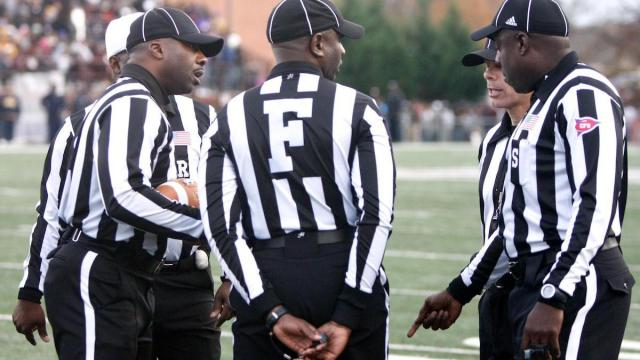 Referees discuss whether the interception resulted in a safety or touchback during the NC A&T vs. NC Central game on November 17, 2012 in Durham, North Carolina.