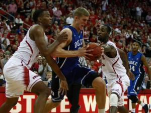 Mason Plumlee (5) goes to the basket against T.J. Warren (24) and C.J. Leslie (5) during the Duke vs. NC State game on January 12, 2013 in Raleigh, North Carolina.