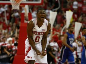 Rodney Purvis (0) gets fired up after a dunk during the Duke vs. NC State game on January 12, 2013 in Raleigh, North Carolina.