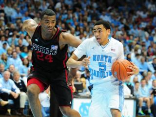 Marcus Paige (5) drives past T.J. Warren (24) during the North Carolina Tar Heels vs. NC State Wolfpack NCAA basketball game, Saturday, February 23, 2013 in Chapel Hill, NC.