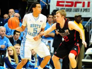 UNC guard Marcus Paige (5) is guarded by NC State guard Tyler Lewis (12) during the North Carolina Tar Heels vs. NC State Wolfpack NCAA basketball game, Saturday, February 23, 2013 in Chapel Hill, NC.