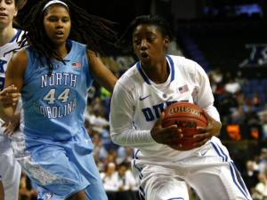 Alexis Jones (2) drives by Tierra Ruffin-Pratt (44) during the championship game of the ACC Women's Basketball Tournament in Greensboro, N.C., Saturday, March 10, 2013.