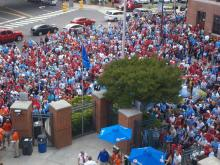 Fans file into Durham Bulls Athletic Park prior to the UNC-NC State baseball game Saturday during the ACC Tournament.