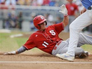 North Carolina State's Brett Austin (11) slides safely into third base against North Carolina third baseman Colin Moran on a fly ball by Tarran Senay in the third inning of an NCAA College World Series baseball game in Omaha, Neb., Sunday, June 16, 2013. (AP Photo/Eric Francis)