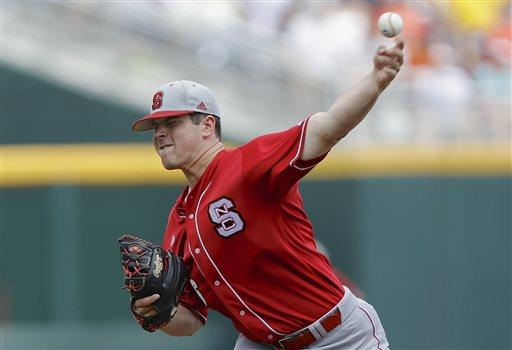 North Carolina State starting pitcher Carlos Rodon throws against North Carolina in the first inning of an NCAA College World Series game in Omaha, Neb., Sunday, June 16, 2013. (AP Photo/Nati Harnik)
