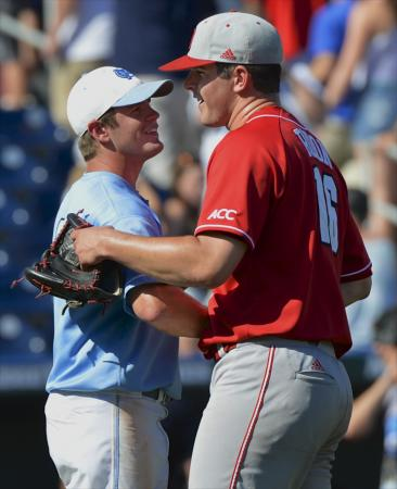 North Carolina State pitcher Carlos Rodon, right, is congratulated by North Carolina's Chaz Frank, following an NCAA College World Series game in Omaha, Neb., Sunday, June 16, 2013. Rodon pitched a complete game and Frank was the only North Carolina player to have scored against him in North Carolina State's 8-1 win. (AP Photo/Ted Kirk)