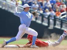 North Carolina State's Trea Turner is out at second base as North Carolina second basemen Mike Zolk, top, throws to first for a double play in the sixth inning of an NCAA College World Series game in Omaha, Neb., Sunday, June 16, 2013. (AP Photo/Eric Francis)