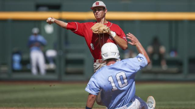 June 16, 2013 - Omaha, Nebraska, United States of America - June 16, 2013: Shortstop Trea Turner #8 of North Carolina State turns a successful double play as North Carolina's Brian Holberton #10 is forced out in action during Game 3 of the 2013 Men's College World Series between the North Carolina State Wolfpack and North Carolina Tarheels at TD Ameritrade Park in Omaha, NE. North Carolina State defeated North Carolina 8-1.Michael Spomer/Cal Sport Media (Cal Sport Media via AP Images)