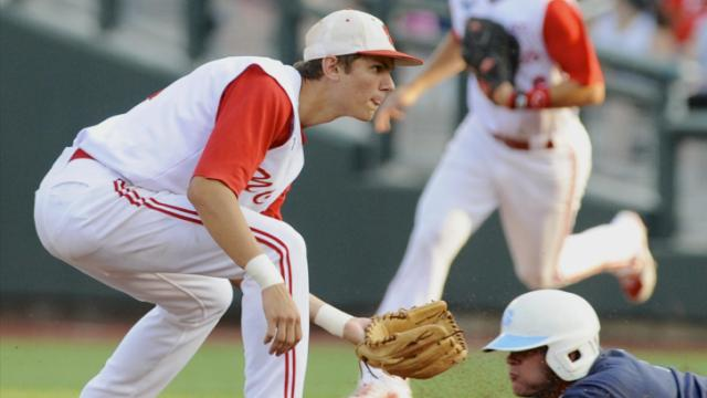 North Carolina's Chaz Frank, right, steals second base against North Carolina State shortstop Trea Turner in the first inning of an NCAA College World Series elimination baseball game in Omaha, Neb., Thursday, June 20, 2013. (AP Photo/Eric Francis)
