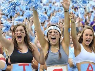 UNC students Alyssa Radel, Rachel Gogal, McKenzie Bennett (L-R) cheer for the Tar Heels during play at Kenan Stadium between the University of North Carolina Tar Heels and the East Carolina Pirates on Septempber 28, 2013 in Chapel Hill, NC.