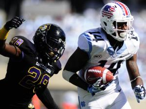 UNC wide receiver Quinshad Davis (14) runs in for a touchdown during play at Kenan Stadium between the University of North Carolina Tar Heels and the East Carolina Pirates on Septempber 28, 2013 in Chapel Hill, NC.