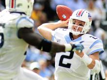 UNC quarterback Bryn Renner (2) drops back to pass during play at Kenan Stadium between the University of North Carolina Tar Heels and the East Carolina Pirates on Septempber 28, 2013 in Chapel Hill, NC.