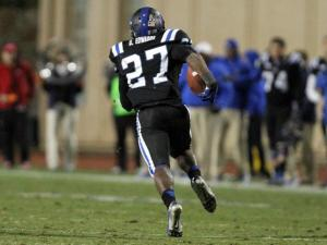 Duke's DeVon Edwards returns a kickoff for a touchdown during the Blue Devils' game versus N.C. State on November 9, 2013 in Durham, NC.  Duke defeated N.C. State 38-20 (Photo by Jack Morton).
